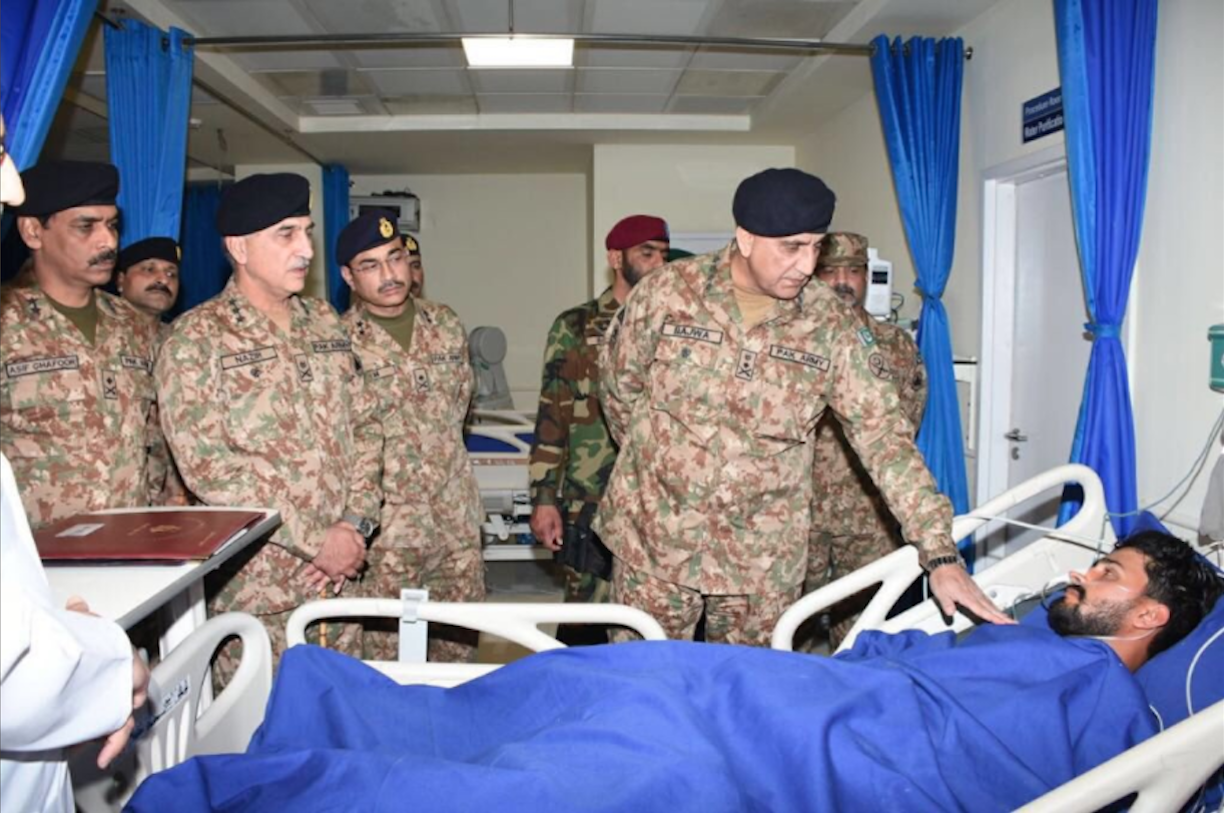 Chief of Army Staff Gen. Qamar Javed Bajwa and other officers February 4 in Peshawar visit soldiers wounded in a Taliban attack a day earlier. The suicide attack killed 11 and wounded 13 troops at an army base in the Swat Valley. [ISPR]