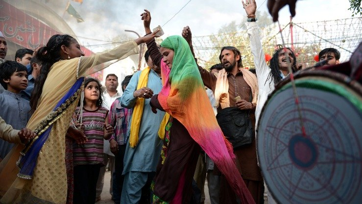 Pakistani devotees dance at the shrine of Muslim Sufi saint Shah Hussain, popularly known as Madho Lal Hussain, during the three-day Mela Chiraghan (the festival of lights) in Lahore last March 25. [Arif Ali/AFP]