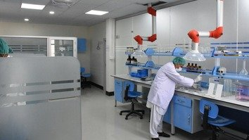 A forensic scientist is examining samples in a criminal case to help police in an investigation on February 1. KP has recently brought its DNA lab online to further help police in investigating terrorism and criminal cases. [Javed Khan]
