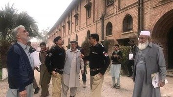 Police officials and faculty members of the Agriculture Service Academy in Peshawar inspect the security arrangements for the resumption of classes on February 6, 2018. [Agriculture Service Academy]