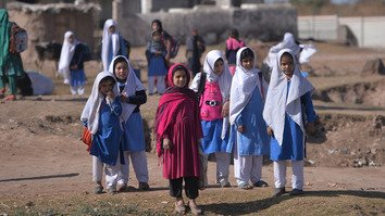 Afghan refugee girls leave after school at a refugee camp on the outskirts of Islamabad February 1. [Aamir Qureshi/AFP]