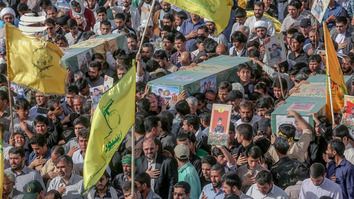 This photo circulated on social media shows a funeral procession in Iran for Shia militia members killed in Syria. The flag of the Iranian Revolutionary Guard Corps-backed Zainabiyoun Brigade, which is made up of Pakistani Shia, is in the foreground.