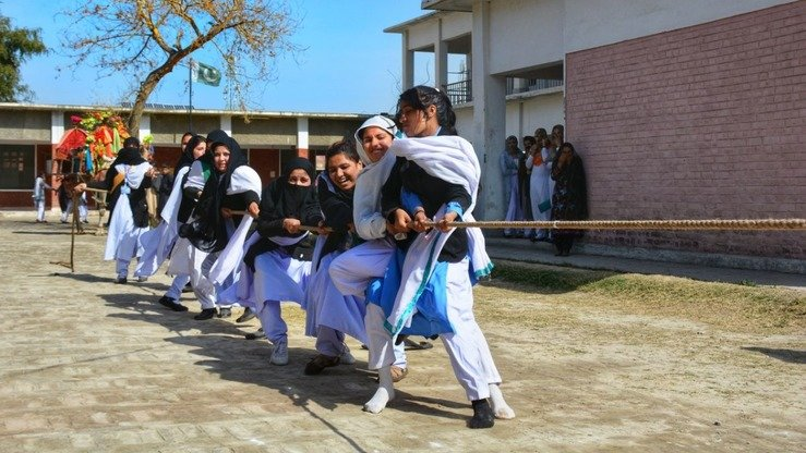 Tribal schoolgirls compete in tug-of-war during the Mohmand Sports Youth and Cultural Festival February 22. [Alamgir Khan]
