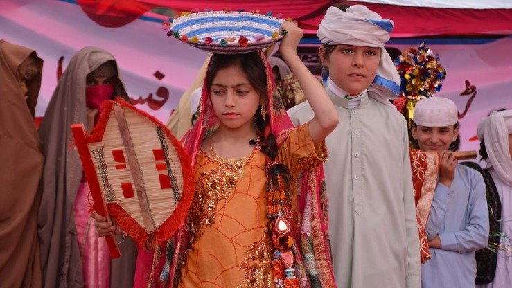 Tribal schoolgirls model local dresses during the Mohmand Sports Youth and Cultural Festival February 22. [Alamgir Khan]
