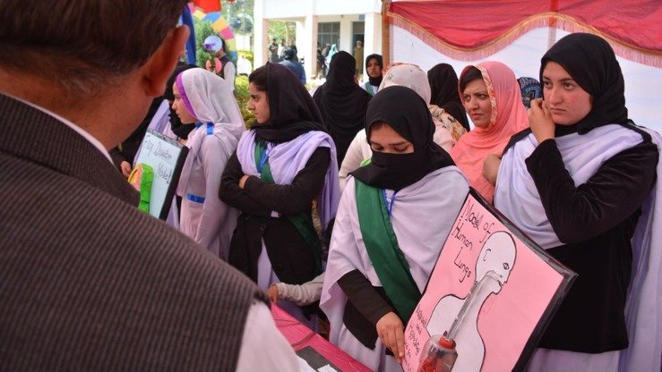 Students display posters at a science stall at the Mohmand Sports Youth and Cultural Festival. [Alamgir Khan]