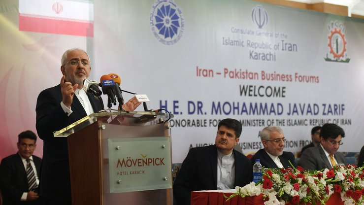 Iranian Foreign Minister Mohammad Javad Zarif speaks at the Iran-Pakistan Business Forums in Karachi March 13. [Asif Hassan/AFP]