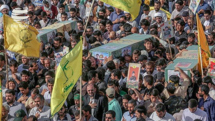This photo circulated on social media shows a funeral procession in Iran for Shia militia members killed in Syria. The flag of the IRGC-backed Zainabiyoun Brigade, which is made up of Pakistani Shia, is in the foreground.