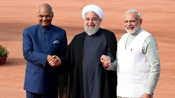 Iranian President Hassan Rouhani (C) holds hands with Indian President Ram Nath Kovind (L) and Indian Prime Minister Narendra Modi (R) during a ceremonial reception at the Indian Presidential palace in New Delhi on February 17, 2018. The Iranian president's three-day official visit to India was marked with rhetoric and business deals that contradict the messages made by Iranian Foreign Minister Mohammad Javad Zarif during his recent visit to Pakistan. [Money Sharma/AFP]