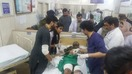 Doctors at Jinnah Hospital in Lahore treat a survivor of a March 14 suicide bombing in nearby Raiwand. [Abdul Nasir Khan]