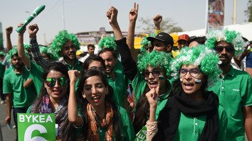 Cricket fans chant outside National Stadium in Karachi March 25 for the Pakistan Super League final between Peshawar Zalmi and Islamabad United. [Rizwan Tabassum/AFP]