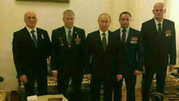 Russian President Vladimir Putin (centre) poses with Dmitry Utkin (far right) and other commanders of the Wagner private military outfit. This image is believed to have been taken in December 2016. [File]