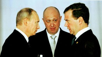 Yevgeny Prigozhin (centre) shares a few words with Russian President Vladimir Putin (left) and Russian Prime Minister Dmitry Medvedev (right) in this undated photo. Prigozhin is widely recognised as the funder of the Wagner Group, Putin's shadowy mercenary army operating in conflict zones in various parts of the world. [File]