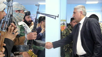 Herat Provincial Governor Mohammad Asif Rahimi greets former Taliban insurgents February 21 in Herat city after they surrendered and admitted to be trained in Iran for sabotage operations.[Sulaiman]