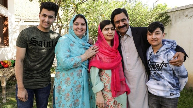 "Malala Yousafzai (centre) poses with her family in a photo posted on Twitter March 31. ""So much joy seeing my family home, visiting friends and putting my feet on this soil again,"" she wrote. [Malala Yousafzai/Twitter]"