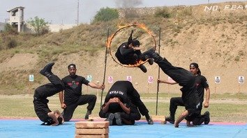 Commandos perform acrobatics during their passing out ceremony at Elite Police Training Centre Nowshera April 3. [Javed Khan]