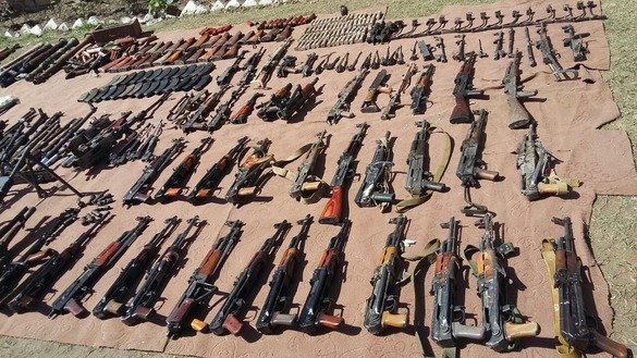 Security forces present a number of AK-47's captured in Kurram Agency April 10. [ISPR]