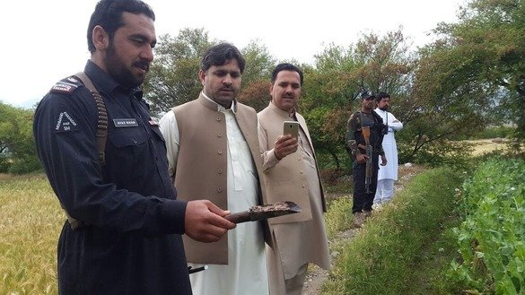 Mohmand Agency political administration officials inspect opium seized during a poppy destruction operation April 21. [Political Administration Mohmand Agency]