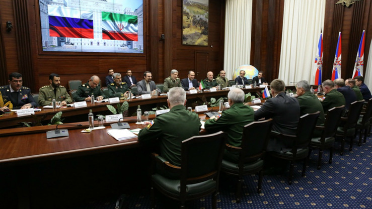 An Iranian military delegation headed by Minister of Defence Amir Hatami meets with Russian military officers headed by armed forces Chief of Staff Gen. Valery Gerasimov April 15 in Moscow. [Iranian Ministry of Defence]