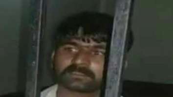 A photo released May 7 shows Abid Hussain in police custody. [Punjab Police]
