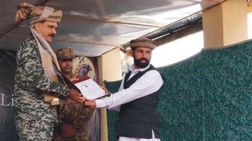 Frontier Corps Inspector General Maj. Gen. Abid Latif April 16 presents certificates to former militants who completed de-radicalisation training in South Waziristan. [Ashfaq Yusufzai]