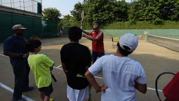 Pakistani tennis coach Mehboob Khan instructs tennis students during a training session in Islamabad July 5, 2015. Officials in KP have passed a new policy requiring sports in schools. [Aamir Qureshi/AFP]