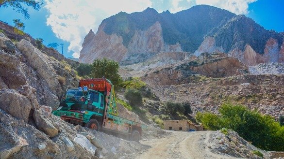 An empty truck heads out to load marble from a mountain in May in Mohmand Agency. [Alamgir Khan]