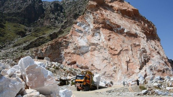 Workers load a truck with marble in May in Mohmand Agency. [Alamgir Khan]