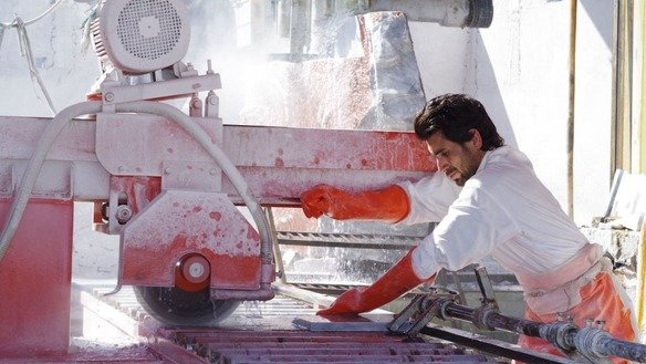 A factory worker processes marble in May in Mohmand Agency. [Alamgir Khan]