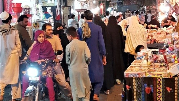 Markets in Nowshera can be seen teeming with shoppers late June 9 in the days before Eid ul Fitr. [Syed Abdul Basit]
