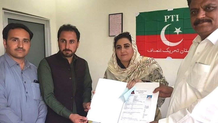 Hameeda Shahid, a Pakistan Tehreek-e-Insaf (PTI) candidate, presents her nomination papers in Upper Dir District June 6. [Courtesy of Hameeda Shahid]