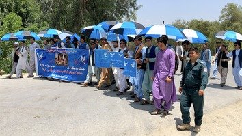 A group of Afghan refugee youth can be seen in Jalalabad on June 21 after starting a peace caravan earlier that day. The group is marching from Peshawar to Kabul to demand the Taliban make peace. [Khalid Zerai]