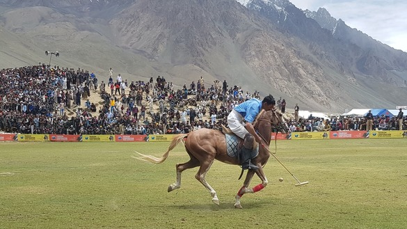 A player from Gilgit-Baltistan Team C aims at the goal before striking the polo ball July 9. Shandur freestyle polo is played using a wooden ball. [Danish Yousafzai]