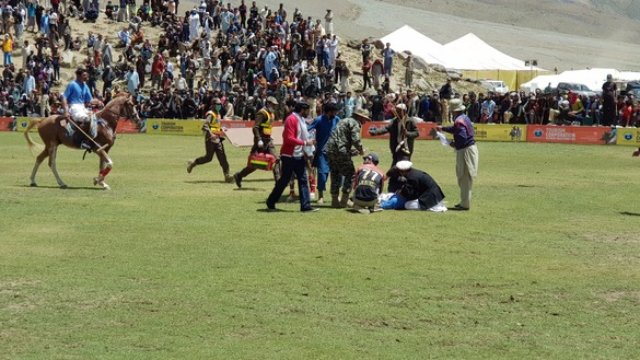 A player from Gilgit-Baltistan lies injured July 9 during a match. Injuries mainly due to the high altitude and low oxygen level are common in Shandur freestyle polo. [Danish Yousafzai]