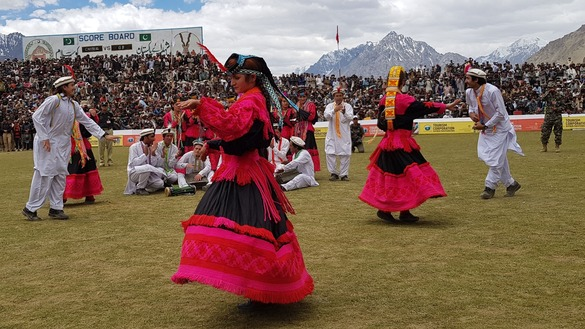Women from Kalash Valley perform a traditional folk dance during halftime July 9. [Danish Yousafzai]