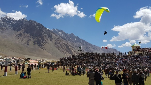 Pakistani troops perform paragliding stunts during halftime July 9. Spectators appreciated the stunning free fall of the paratroopers. [Danish Yousafzai]