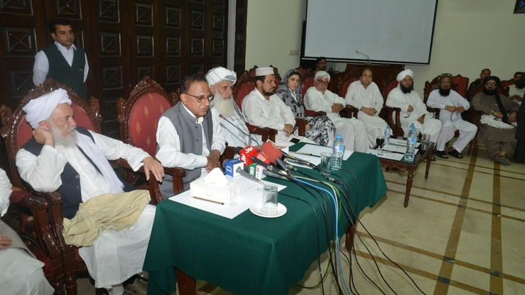 KP Caretaker Chief Minister Dost Muhammad Khan  (second left) and political leaders speak to reporters in Peshawar July 14. [Muhammad Ahil]