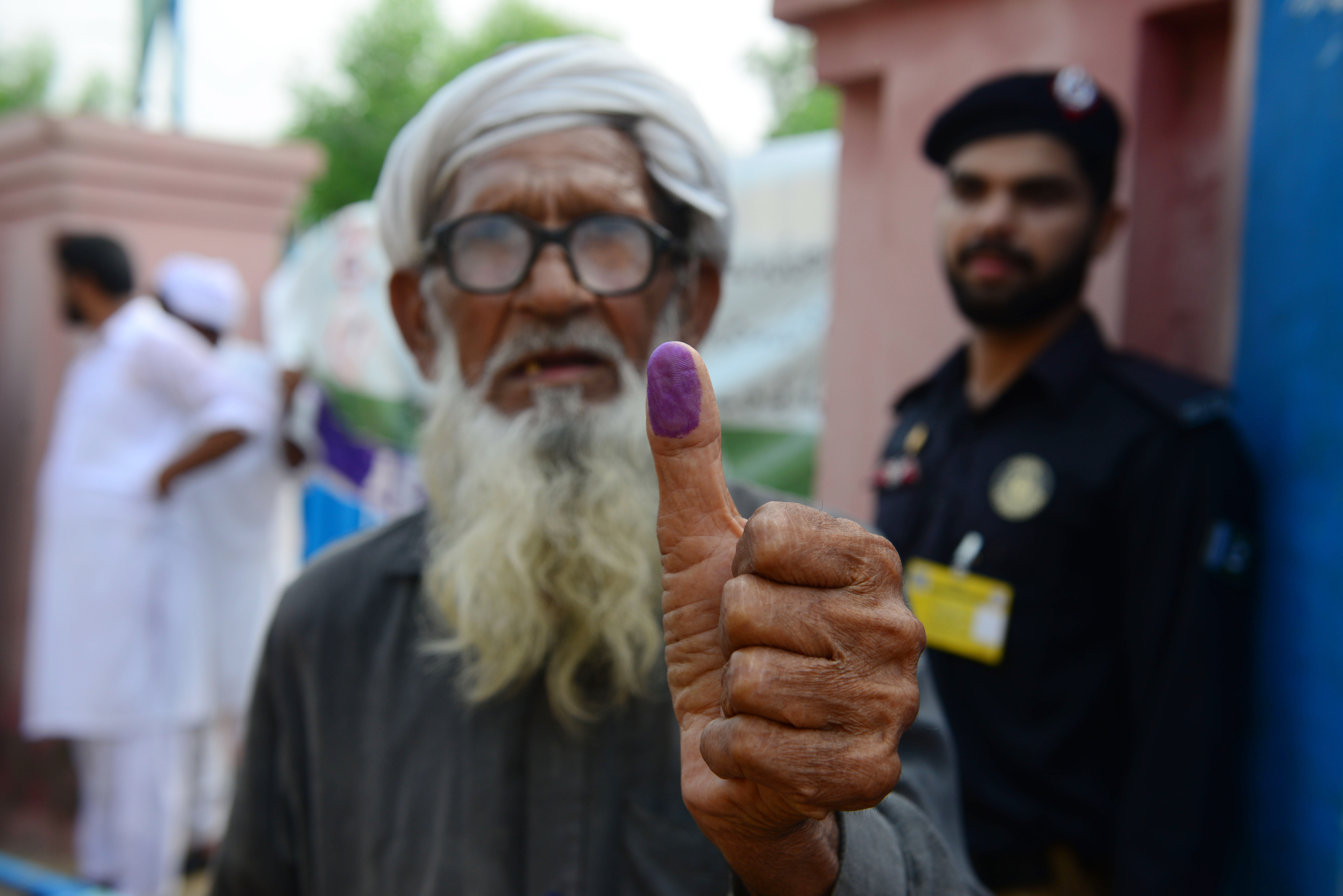 Pakistani voters defy violence, await results of tight race