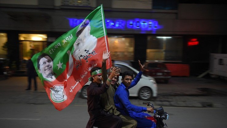 Supporters of Pakistan Tehreek-e-Insaf (PTI) Chairman Imran celebrate in Rawalpindi July 25 after voting closed in a general election. Khan declared victory July 26, as the nation awaited official results from the Election Commission of Pakistan. [Farooq Naeem/AFP]
