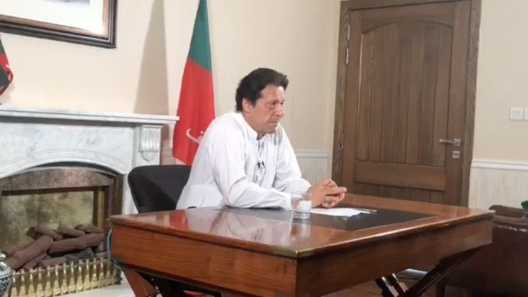 PTI Chairman Imran Khan declares victory in Pakistan's general elections in a video address from Bani Gala, Islamabad, July 26. [Imran Khan/Facebook]