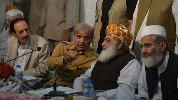 Pakistani opposition leader Maulana Fazl-ur-Rehman (second right) and Shahbaz Sharif (second left), the head of Pakistan Muslim League-Nawaz (PML-N), attend an All Parties Conference in Islamabad July 27. [Aamir Qureshi/AFP]