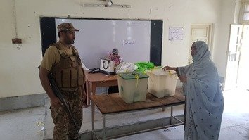 A woman casts her vote in the July 25 general elections in Dera Ismail Khan District. [Muhammad Ahil]