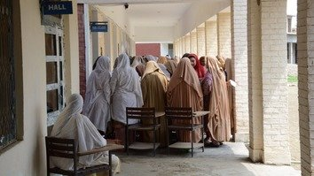 Female voters wait in line to vote in the July 25 general elections in Mohmand District. [Alamgir Khan]