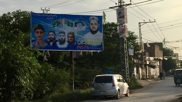 A Peshawar billboard depicts Ibrahim Qasmi, head of the Rah-e-Haq Party. He was defeated in a race for a Khyber Pakhtunkhwa Assembly seat during July 25 polls. [Javed Khan]