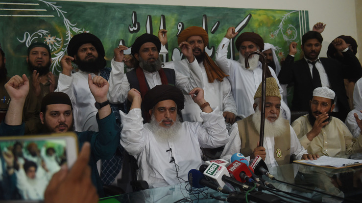 The leader of the Tehreek-e-Labaik Pakistan (TLP) party, Khadim Hussain Rizvi (front centre), gestures as he speaks to media in Lahore July 30. [Arif Ali/AFP]