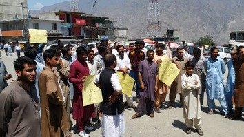 Members of the Diamer Youth Movement demonstrate against the recent burning of a dozen schools in the district at Siddique Akbar Chowk in Chilas on August 5. [Muhammad Ahil]