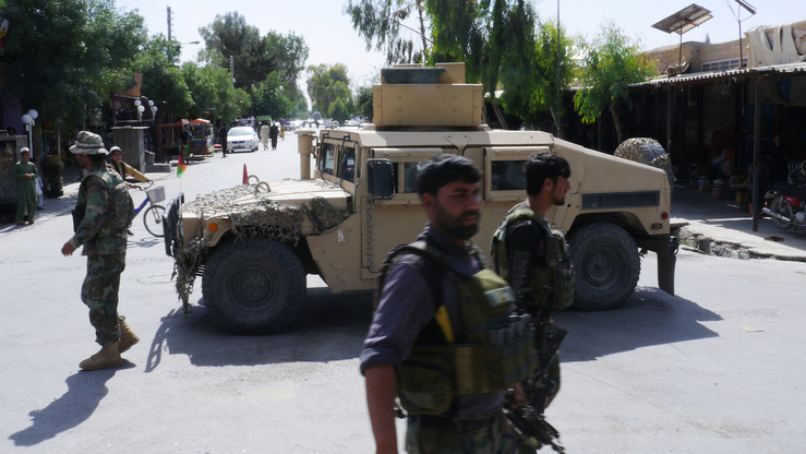 Afghan security forces May 19 patrol after regaining control of Farah city from Taliban militants. Iran orchestrated the militant attack, local officials say. [Hameed Kham/AFP]