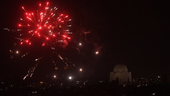 Fireworks are seen over Karachi as part of Independence Day celebrations August 14. [Asif Hassan/AFP]