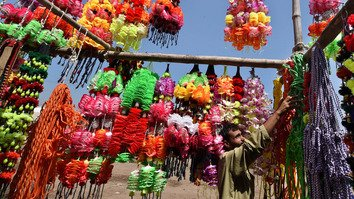 In photos: Peshawar residents prepare for Eid ul Adha