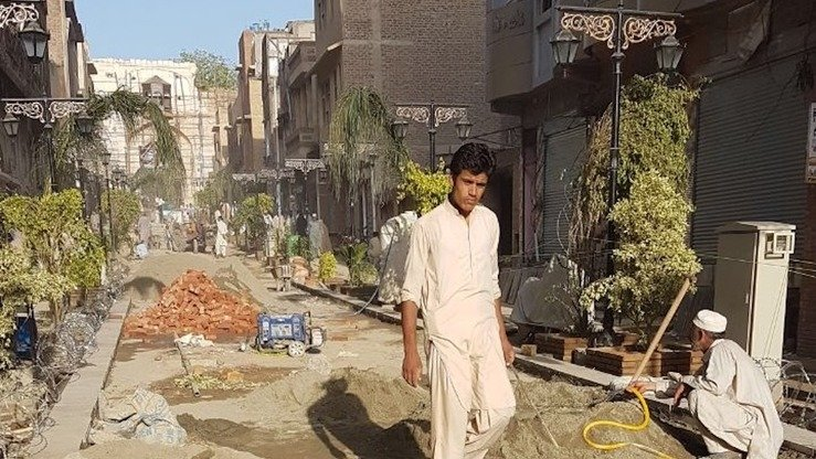 Construction work proceeds on the Heritage Trail in Peshawar May 3. [Javed Khan]