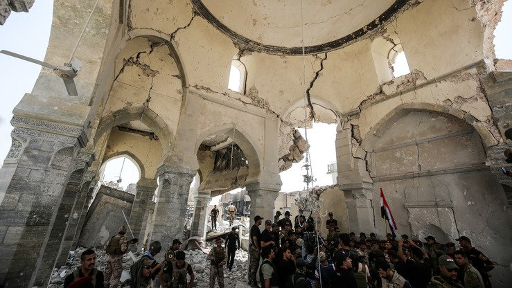 Members of the Iraqi forces are shown July 2, 2017, at the al-Nuri mosque in Mosul, Iraq, where Abu Bakr al-Baghdadi gave his first sermon as leader of ISIS in 2014. On June 23, 2017, ISIS blew up the mosque while Iraqi forces encircled the area, levelling the building along with its ancient minaret. [Ahmad al-Rubaye/AFP]